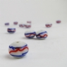 White Glass Bead with Red and Blue Trails