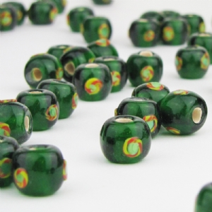 Green Glass Bead with Red and Yellow Circular Detail